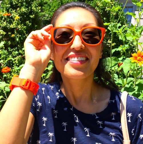 Sunkist orange accents for a sunkissed summer: Tory Burch sunglasses, Nixon watch, J.Crew palm tree tee.